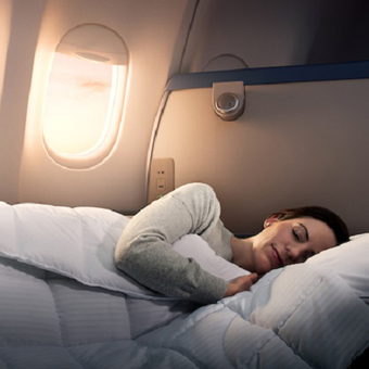 A woman sleeping in Delta One on an Airbus 330-300 (333). - These images are protected by copyright. Delta has acquired permission from the copyright owner to the use the images for specified purposes and in some cases for a limited time. If you have been authorized by Delta to do so, you may use these images to promote Delta, but only as part of Delta-approved marketing and advertising. Further distribution (including proving these images to third parties), reproduction, display, or other use is strictly prohibited.